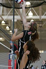 Picture of TNT Volleyball Girls hitting ball over net